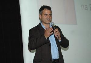 Carlos em palestra sobre o programa. Crédito: Divulgação